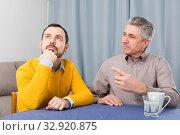Mature father and son serious talk. Стоковое фото, фотограф Яков Филимонов / Фотобанк Лори