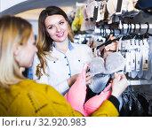 Купить «Shop assistant in underwear store», фото № 32920983, снято 20 марта 2017 г. (c) Яков Филимонов / Фотобанк Лори