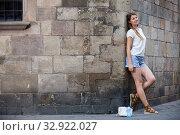 Young woman on old stone wall background. Стоковое фото, фотограф Яков Филимонов / Фотобанк Лори