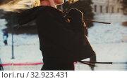 Купить «A young beautiful blonde woman professional figure skater on ice rink spinning around herself - sunset lighting», видеоролик № 32923431, снято 29 марта 2020 г. (c) Константин Шишкин / Фотобанк Лори