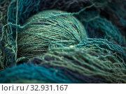 Купить «Threads and skein of variegated yarn close-up», фото № 32931167, снято 18 ноября 2019 г. (c) Елена Вишневская / Фотобанк Лори