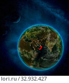 Oman from space on Earth at night surrounded by space with Moon and Milky Way. Detailed planet with city lights and clouds. 3D illustration. Elements of this image furnished by NASA. Стоковое фото, фотограф Zoonar.com/Tomas Griger / easy Fotostock / Фотобанк Лори