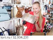 Купить «Woman buys hand bag», фото № 32934231, снято 27 мая 2017 г. (c) Яков Филимонов / Фотобанк Лори