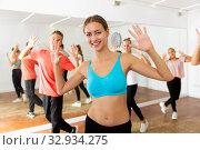Купить «Female dance teacher practicing with group of teens», фото № 32934275, снято 18 февраля 2020 г. (c) Яков Филимонов / Фотобанк Лори