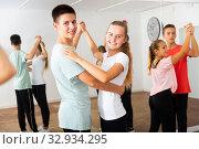 Teens in pairs learning to dance waltz. Стоковое фото, фотограф Яков Филимонов / Фотобанк Лори
