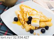 Купить «Crepes with brie and honey», фото № 32934427, снято 9 июля 2020 г. (c) Яков Филимонов / Фотобанк Лори