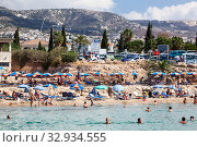 The Coral Bay beach with sandy seacoast and waterfront. It carries an EU Blue Flag. It is a popular tourist resort in the Peyia municipality on the Mediterranean sea. Paphos, Cyprus (2013 год). Редакционное фото, фотограф Кекяляйнен Андрей / Фотобанк Лори