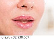 Купить «Close-up of female's lips with natural lipstick make up. macro lipgloss make-up», фото № 32938067, снято 15 июня 2017 г. (c) Яков Филимонов / Фотобанк Лори
