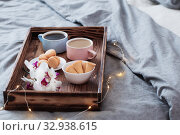 Купить «two cup of coffee on wooden tray in bedroom», фото № 32938615, снято 14 января 2020 г. (c) Майя Крученкова / Фотобанк Лори