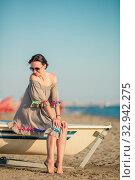 Купить «Beautiful woman on the beach on Amalfi coast in Italy», фото № 32942275, снято 30 июля 2016 г. (c) Дмитрий Травников / Фотобанк Лори