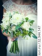 Купить «Bride with bunch of flowers.», фото № 32944147, снято 5 апреля 2020 г. (c) easy Fotostock / Фотобанк Лори