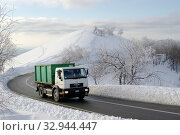 Купить «Trucks traverse the paved road in a mountain winter landscape,mottarone,piedmont,italy.», фото № 32944447, снято 7 июня 2020 г. (c) easy Fotostock / Фотобанк Лори