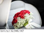 Купить «Bouquet on the seat of a car.», фото № 32946147, снято 5 апреля 2020 г. (c) easy Fotostock / Фотобанк Лори