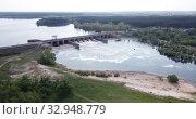 Купить «Aerial view of concrete dam on water reservoir near Voronezh, Russia», видеоролик № 32948779, снято 4 мая 2019 г. (c) Яков Филимонов / Фотобанк Лори