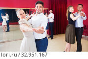 Купить «People learning to dance waltz in dancing class», фото № 32951167, снято 24 мая 2017 г. (c) Яков Филимонов / Фотобанк Лори