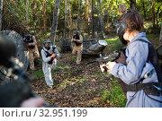Купить «Paintball players shooting with guns», фото № 32951199, снято 23 января 2020 г. (c) Яков Филимонов / Фотобанк Лори