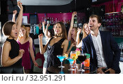 Купить «Colleagues dancing on corporate party with cocktails in hands», фото № 32951291, снято 20 апреля 2017 г. (c) Яков Филимонов / Фотобанк Лори