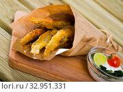 Купить «Deep fried anchovies with creamy cheese sauce», фото № 32951331, снято 23 августа 2018 г. (c) Яков Филимонов / Фотобанк Лори