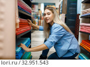 Купить «Saleswoman measures fabric in textile store», фото № 32951543, снято 8 ноября 2019 г. (c) Tryapitsyn Sergiy / Фотобанк Лори