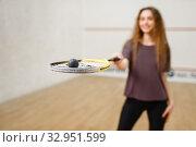 Female person shows squash racket and ball. Стоковое фото, фотограф Tryapitsyn Sergiy / Фотобанк Лори