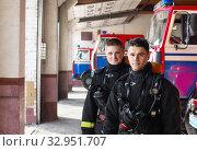Купить «young firefighters on the background of fire engines», фото № 32951707, снято 21 октября 2019 г. (c) Майя Крученкова / Фотобанк Лори