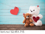 Купить «Teddy bear with red heart on old wooden background. Valentine's», фото № 32951715, снято 14 декабря 2019 г. (c) Майя Крученкова / Фотобанк Лори