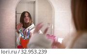 Купить «A young woman dancing and singing with a hair brush in her hand wearing a bathrobe - walking in the bathroom», видеоролик № 32953239, снято 6 июня 2020 г. (c) Константин Шишкин / Фотобанк Лори