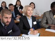 Купить «People during business seminar in lecture hall», фото № 32953515, снято 12 февраля 2018 г. (c) Яков Филимонов / Фотобанк Лори
