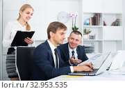 Купить «Two young business male and woman in firm office», фото № 32953535, снято 31 мая 2020 г. (c) Яков Филимонов / Фотобанк Лори