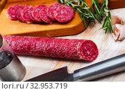 Купить «Sliced half-smoked sausages on wooden table. Traditional spanish meat product», фото № 32953719, снято 29 февраля 2020 г. (c) Яков Филимонов / Фотобанк Лори