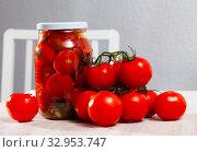 Купить «Pickled tomatoes in glass jar», фото № 32953747, снято 29 мая 2020 г. (c) Яков Филимонов / Фотобанк Лори