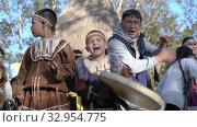Boy with tambourine dancing in traditional clothing of aboriginal people of Kamchatka. Itelmens national ritual festival thanksgiving nature Alhalalalay. Kamchatka Peninsula (2019 год). Редакционное видео, видеограф А. А. Пирагис / Фотобанк Лори