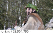 Young woman sings song in Itelmen language and dances in traditional clothing of aboriginal people. Itelmens national ritual festival thanksgiving nature Alhalalalay. Kamchatka Peninsula (2019 год). Редакционное видео, видеограф А. А. Пирагис / Фотобанк Лори