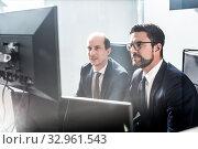 Купить «Business team analyzing data at business meeting in modern corporate office.», фото № 32961543, снято 10 января 2020 г. (c) Matej Kastelic / Фотобанк Лори