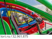 Купить «Colored electric cars in Kazan», фото № 32961875, снято 23 мая 2019 г. (c) Дмитрий Тищенко / Фотобанк Лори