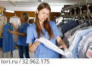 Купить «Workers inspecting clothes after cleaning», фото № 32962175, снято 22 января 2019 г. (c) Яков Филимонов / Фотобанк Лори