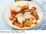 Купить «Eggs fried with pork meat and tomatoes», фото № 32962275, снято 26 февраля 2020 г. (c) Яков Филимонов / Фотобанк Лори