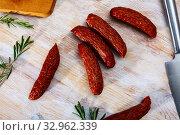 Купить «Sliced half-smoked sausages susena on wooden table. Traditional Chezh meat products», фото № 32962339, снято 29 февраля 2020 г. (c) Яков Филимонов / Фотобанк Лори