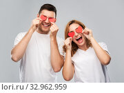 Купить «happy couple with red hearts instead of eyes», фото № 32962959, снято 6 октября 2019 г. (c) Syda Productions / Фотобанк Лори