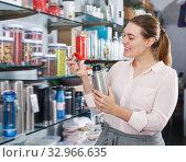Купить «Nice woman consumer with thermos», фото № 32966635, снято 2 мая 2018 г. (c) Яков Филимонов / Фотобанк Лори