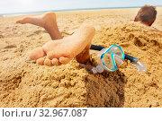 Snorkel, mask and boy feet buried in sand beach. Стоковое фото, фотограф Сергей Новиков / Фотобанк Лори