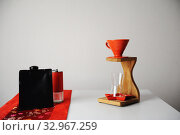 Chinese specialty coffee concept. Manual brewing. Traditional China fabric pattern tablecloth. Wooden drip station. Стоковое фото, фотограф Кристина Сорокина / Фотобанк Лори