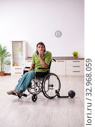 Купить «Young male invalid in wheel-chair suffering at home», фото № 32968059, снято 23 июля 2019 г. (c) Elnur / Фотобанк Лори