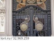 Купить «The ornamented entrance to the Colegio Notarial Buiilding. City of Valencia, Comunidad Valenciana, Spain, Europe.», фото № 32969259, снято 20 июня 2019 г. (c) age Fotostock / Фотобанк Лори