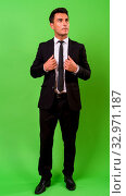 Купить «Studio shot of young handsome Hispanic businessman against chroma key with green background», фото № 32971187, снято 25 января 2020 г. (c) easy Fotostock / Фотобанк Лори