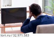 Businessman watching tv in the office. Стоковое фото, фотограф Elnur / Фотобанк Лори