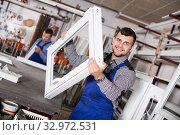 Workman showing PVC manufacturing output. Стоковое фото, фотограф Яков Филимонов / Фотобанк Лори
