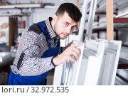 Careful workman inspecting PVC manufacturing. Стоковое фото, фотограф Яков Филимонов / Фотобанк Лори
