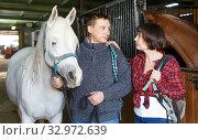Купить «Portrait of man and woman with roan horse», фото № 32972639, снято 26 ноября 2018 г. (c) Яков Филимонов / Фотобанк Лори