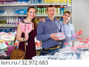Купить «couple and teenager with household goods purchase in the store», фото № 32972683, снято 13 апреля 2017 г. (c) Яков Филимонов / Фотобанк Лори